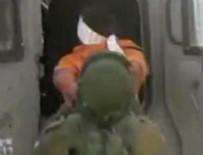 İsrail askerleriden engelli çocuğa kelepçe