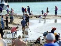 Dedektörü kapan sahile koştu