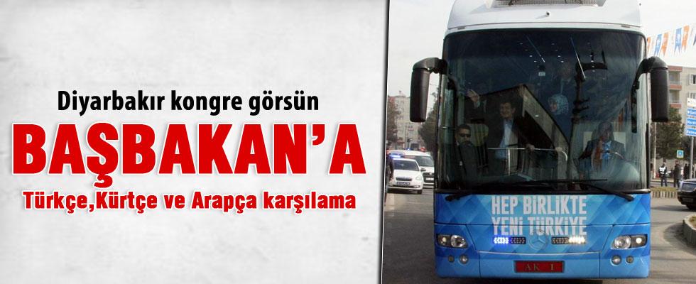 Başbakan Davutoğlu'na üç dilli karşılama