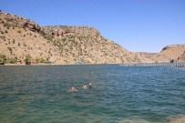 Sıcaktan Bunalan Vatandaşlar Eğil Barajı'na Akın Etti