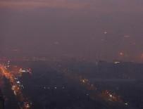 SERA ETKISI - Çin'de hava kirliliği nedeniyle kırmızı alarma geçildi