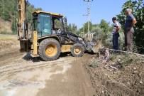 Turgutlda Şiddetli Yağmur Sonrası Yaralar Sarılıyor