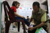 İHH, Doğu Guta'da Yetim Çocuklara Ayakkabı Dağıttı