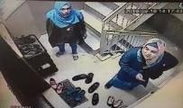 KADIN HIRSIZ - Genç kadın kamerayı görünce şok oldu!