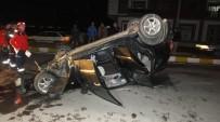 Burhaniye'de Otomobil Orta Refüje Çarpıp Takla Attı