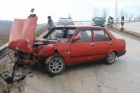 Kaygan Yolda Kontrolden Çıkan Araç Bariyerlere Çarparak Durabildi