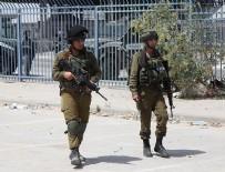 BIÇAKLI SALDIRI - İsrail polisi bir Filistinliyi öldürdü