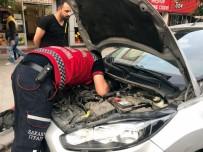 ATATÜRK BULVARI - Park Halindeki Otomobilin Motoruna Sıkışan Kediyi İtfaiye Kurtardı