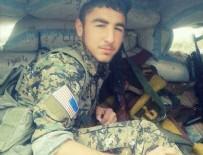 PYD - PKK'lı teröristin kolunda Amerikan bayrağı