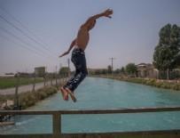 SU KANALI - Şanlıurfa'da sıcak hava bunaltıyor