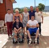 SOSYAL HAYAT - Didim'de Yabancılar İki Engelliye Akülü Sandalye Bağışladı