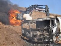 ÖRGÜT PROPAGANDASI - PKK'lı teröristler iş makinelerini yaktı