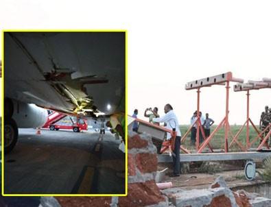 Yolcu uçağı havalimanı duvarına çarptı!