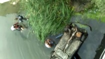 Nehre Düşen Araçtaki Anne, Baba Ve Bebeği Kurtardı