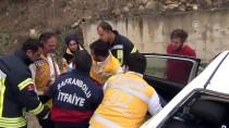 Yoldan Çıkan Otomobil 50 Metrelik Şarampole Devrildi
