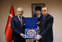 Erdoğan'dan Enver Yılmaz'a Plaket