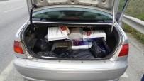 KAÇAK İÇKİ - Otomobilden Kaçak İçki Ve Sigara Çıktı