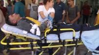 BUHARA - Kırık Cam Parçalarının Üzerine Düşen 2 Kardeş Yaralandı