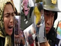 ÇİN - Çin'den görülmemiş zulüm: Müslüman kadınların elbiselerini kestiler!