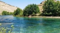 Nehirde Mahsur Kalan Anne Ve Oğlunu İtfaiye Kurtardı