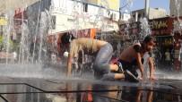 Kızıltepe'de Çocuklar Süs Havuzlarında Serinliyor