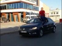 POLİS MERKEZİ - Arabayı Tavanına Oturup Kullanan Sürücüye Ceza