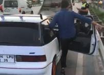 Abartı Egzozlu Aracı Bağlanınca Yumrukla Camlarını Kırdı