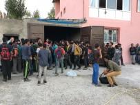 GÖÇMEN KAÇAKÇILIĞI - Van'da Bir Garajda 244 Kaçak Göçmen Yakalandı