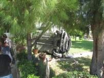 Ayvalık'ta Kontrolden Çıkan Otomobil Takla Atarak Bahçeye Daldı
