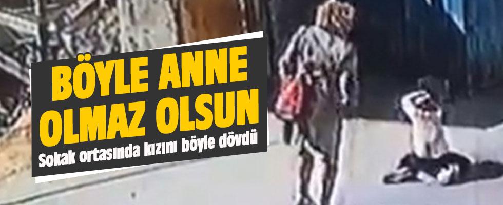 Sokak ortasında kızını dövdü