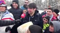 Karda Yuvarlanan Kaşarı Yakalamak İçin Yarıştılar