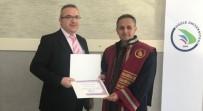 DPÜ'lü Öğretim Üyesi Dr. Şenol'a Ödül
