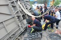 Devrilen Halk Otobüsünün Altında Kalan Yaralıyı İtfaiye Kurtardı