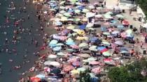 İLGİNÇ GÖRÜNTÜ - Zonguldak'ta Sıcaktan Bunalanlar Plajlara Akın Etti