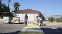 Döşemealtı Belediyesi Okul Önlerindeki Yaya Geçitleri Ve Kasisleri Boyuyor
