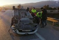 Manisa'da Otomobil Karşı Şeride Geçip Takla Attı Açıklaması 1 Yaralı
