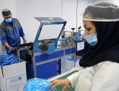 İran'da fabrikalar tıbbi maske yetiştirebilmek için 24 saat çalışıyor