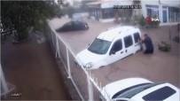 Selde sürüklenen aracını elleriyle tuttu, park etti, iple bağladı