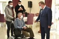 Engellilere Tekerlekli Sandalye İle Kıyafet Dağıtıldı