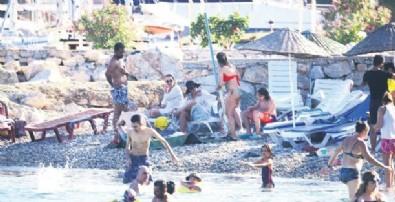 Burçin Terzioğlu halk plajına gitti!