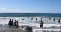 Denizde Bogulma Tehlikesi Atlatan Adamin Yardimina Büfe Çalisani Ve Iki Sörfçü Yetisti
