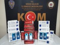 Polisler, Kaçak Telefon Ve Sigara Ele Geçirdi