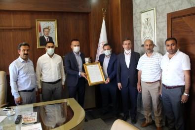 Önder Dernegi Bölge Sorumlusu Yildirim'dan Milli Egitim Müdürü Tekin'e Ziyaret