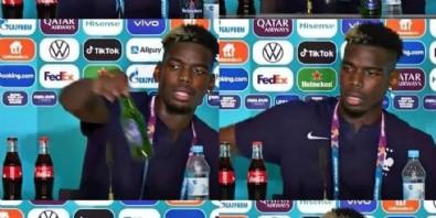 Fransa Milli Takımı'nın Müslüman yıldızı Paul Pogba basın toplantısında önündeki bira şişesini kaldırdı