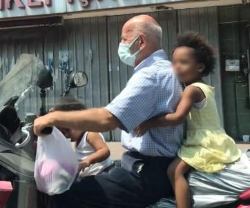 Beyoglu'nda Iki Çocukla Tehlikeli Motor Yolculugu