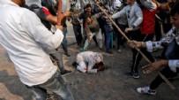Hindistan'da Müslümanlara zulüm! Kemerle dövüp, mezarlığa saldırdılar...
